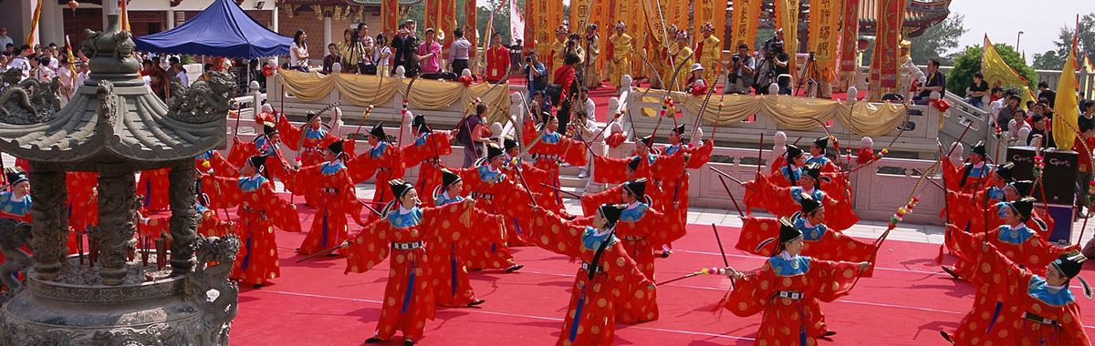 Raging colours: a glamorous traditional performance in Macau.