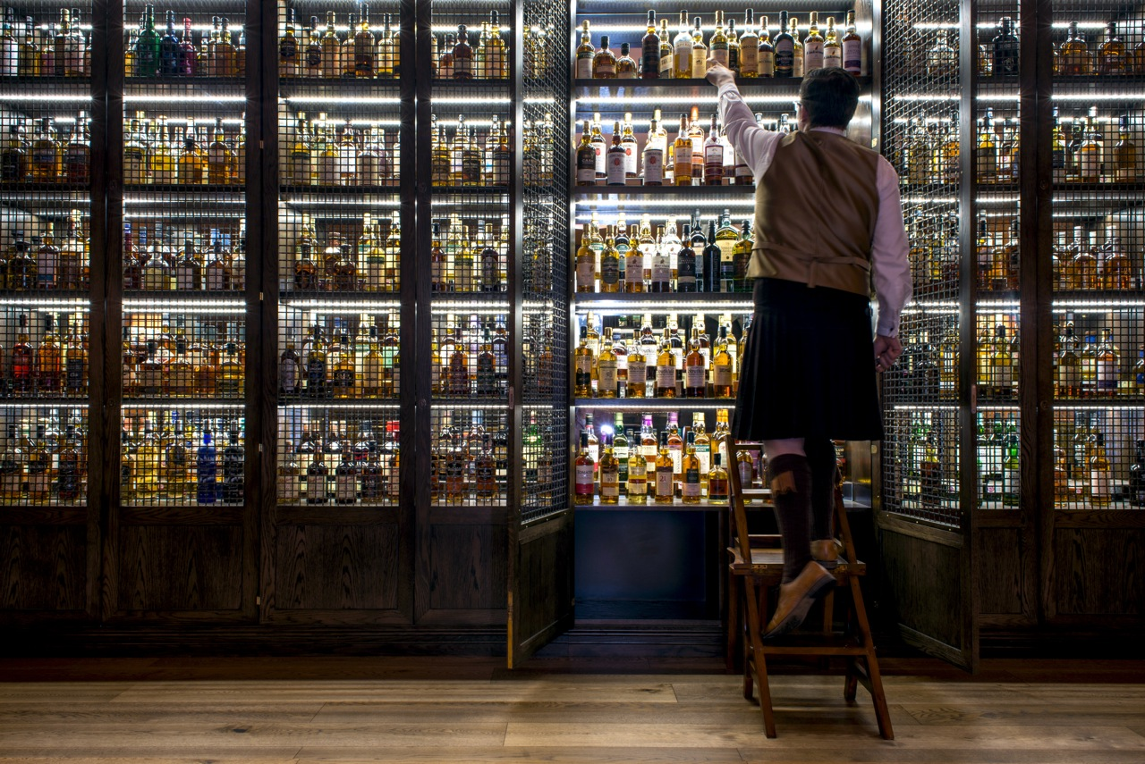 One of the three Whisky Ambassadors stepping up high for the guests of the Scotch bar at the Balmoral Hotel in Edinburgh.