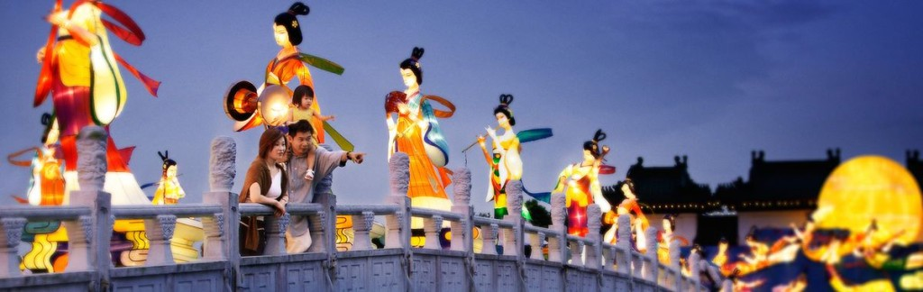 Procession of traditional figures: When Singapore celebrates, even bridges become colourful stages.