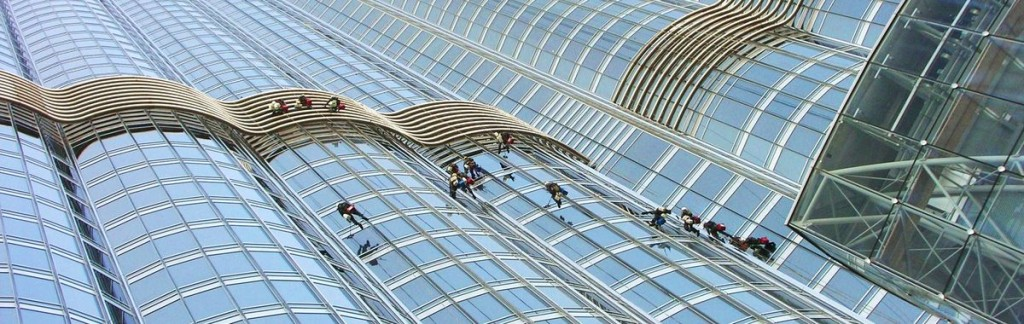 Window cleaners on Burj Khalifa - the epitome of the emirate's economic success.