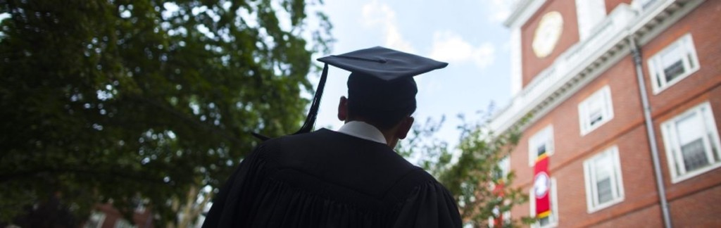 A graduate in academic gear and mortarboard