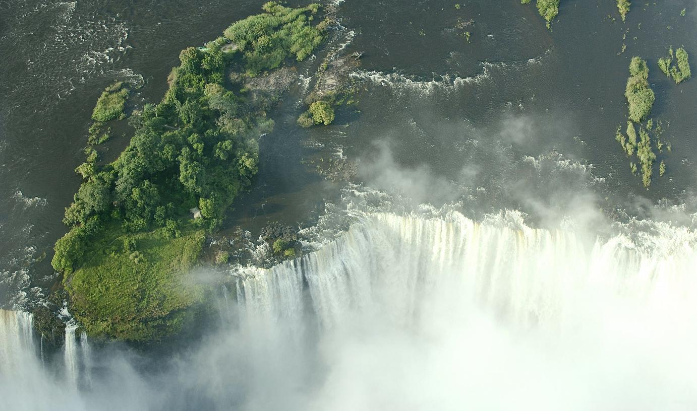 Livingstone Island is the only accesible land on right on the edge of the Victoria Falls, and the first place David Livingstone observed the falls from.    Livingstone Island is only accesible from Zambia.  Tongabezi organise daily trips.