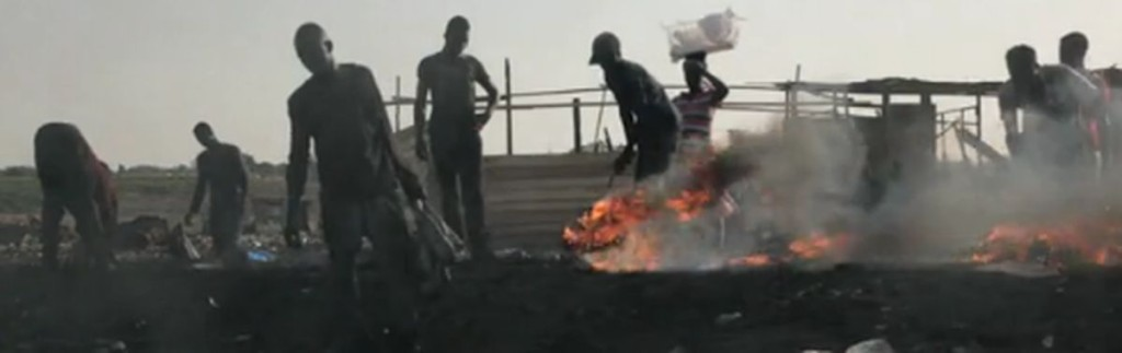 Workers burning harmful waste at the Agobogbloshie dump in Ghana.