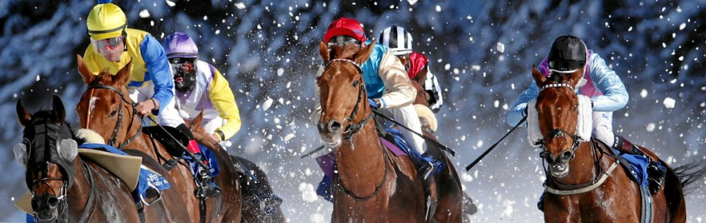 Horses galopping in the snow: The White Turf Horse Race in St. Moritz.