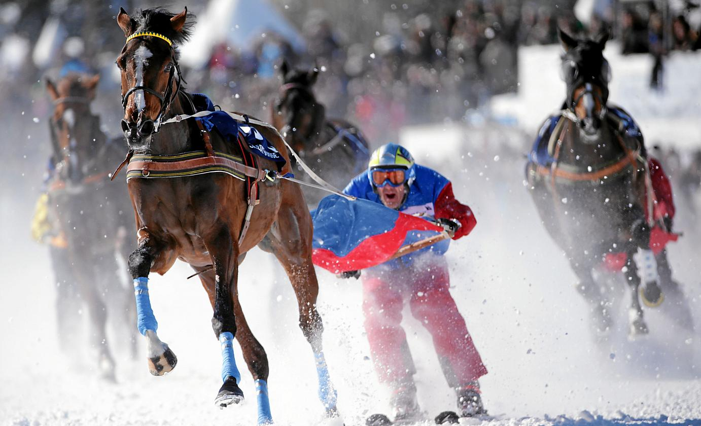"The first ""skijöring"" race took place in 1906, following a route from St. Moritz to Champfèr. Today, flatracing and trotting competitions form part of the challenge. swiss-image.ch/Photo Andy Mettler"