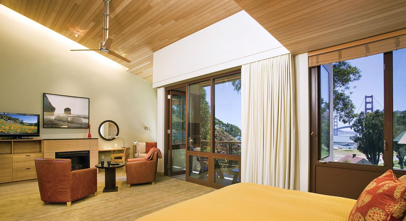 Set on a hillside are 74 newly constructed Contemporary rooms and suites with solar power, radiant heat floors, renewable materials, organic bedding and linens, and natural amenities enhancing the lodge's location. ©Kodiak Greenwood