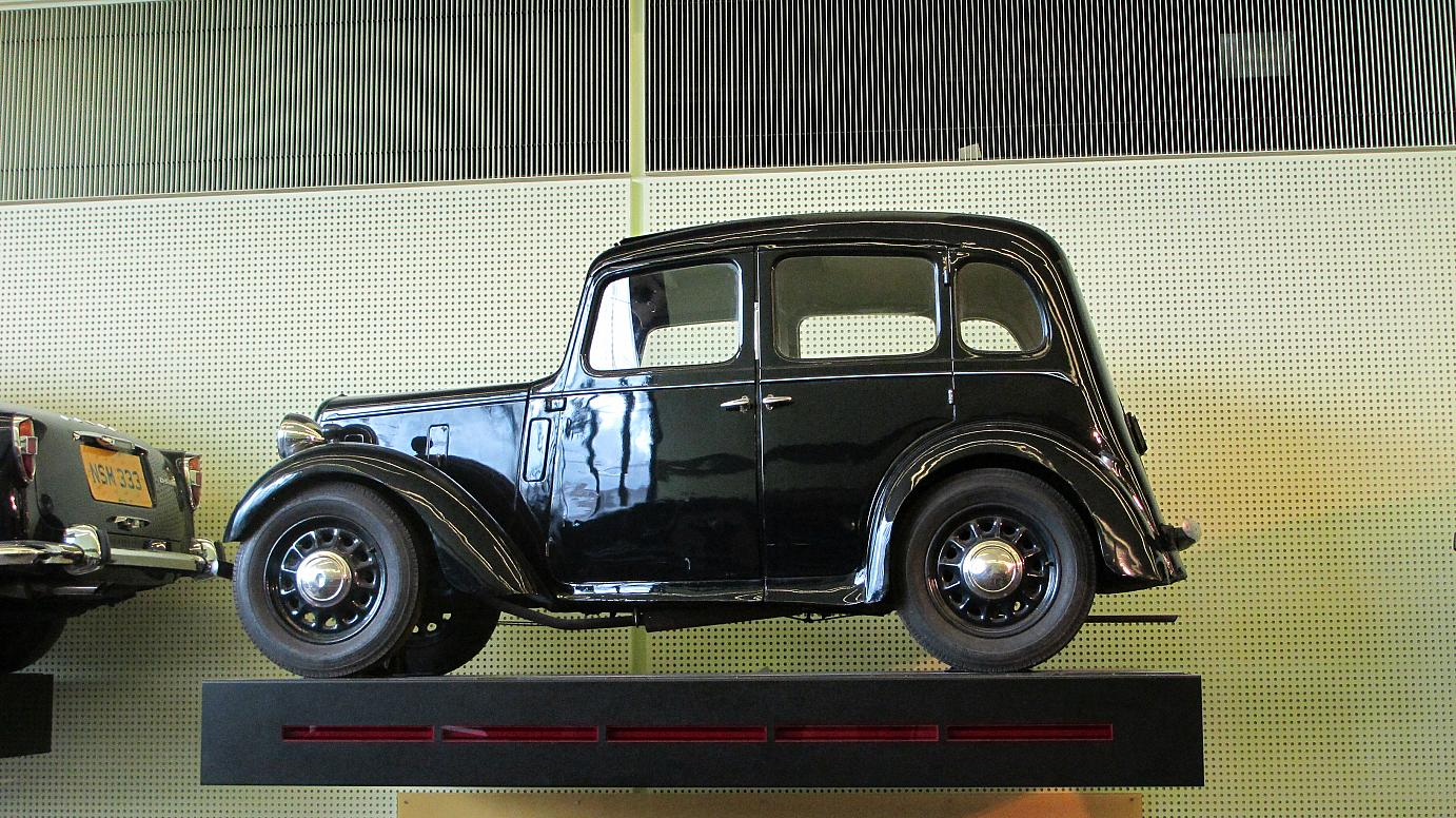 A cute little Oldtimer car exhibited at the Riverside Museum in Glasgow.