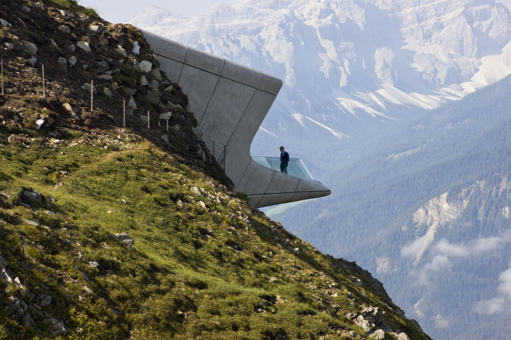 "Zaha Hadid explains the concept of her design: ""The idea is that visitors can descend within the mountain to explore its caverns and grottos, before emerging through the mountain wall on the other side, out onto the terrace overhanging the valley far below with spectacular, panoramic views."" To reduce its footprint, the Corones' 1,000 sqms space is arranged over several levels. By immersing the museum within Mount Kronplatz, a more constant internal temperature can be maintained. To achieve this effect, 4,000 cubic meters (140,000 cubic feet) of earth and rock were excavated and then again replaced above and around the finished structure."