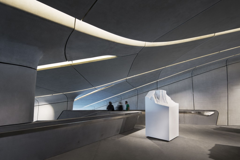 Inside, waterfall-resembling staircases cascade through the museum. At the lowest level the terrace, projecting six metres from the mountainside, offers a spectactular 240 degree panorama view across the Alps. Photo credit: ©Werner Huthmacher. www.zaha-hadid.com