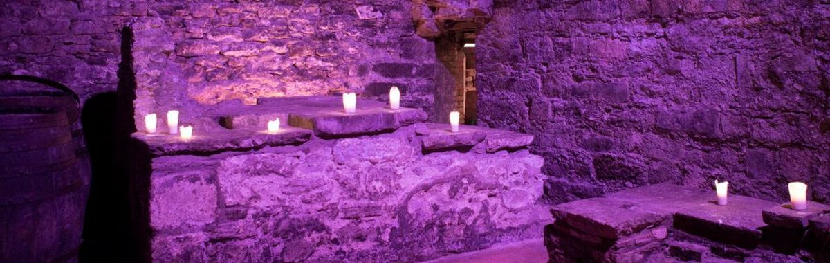 Doused in purple light: A restaurant in the Caves in Edinburgh's underground.