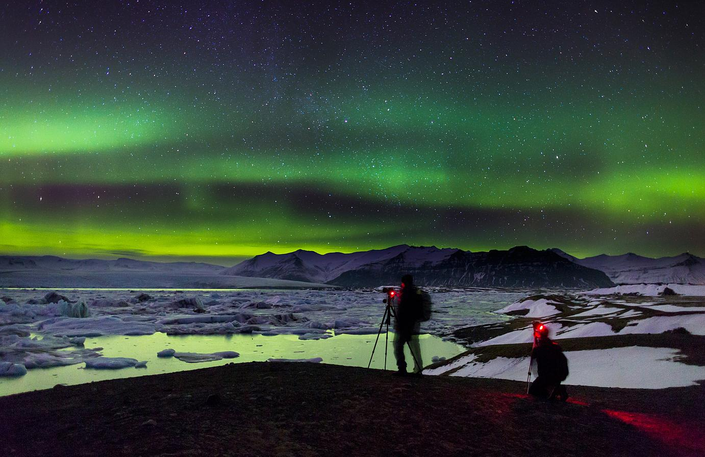 Camera lights glowing at the Jökulsarlon glacier in Iceland.