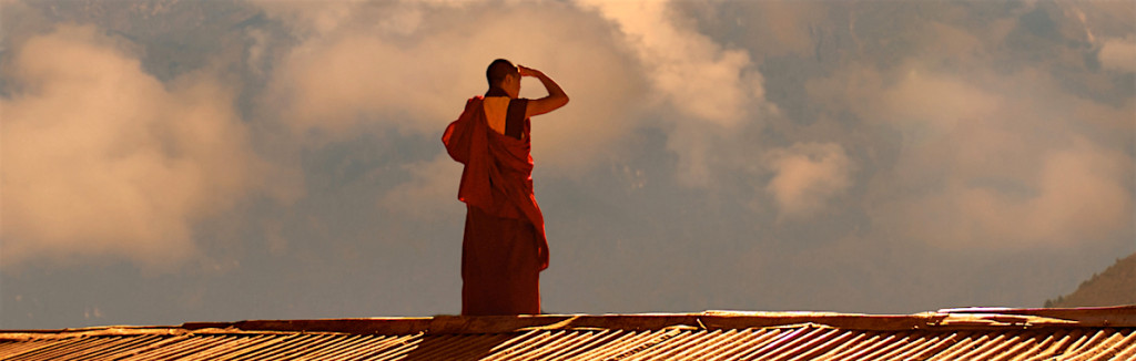 A monk on a rooftop in the Himalayans. Copyright: Marco Roth